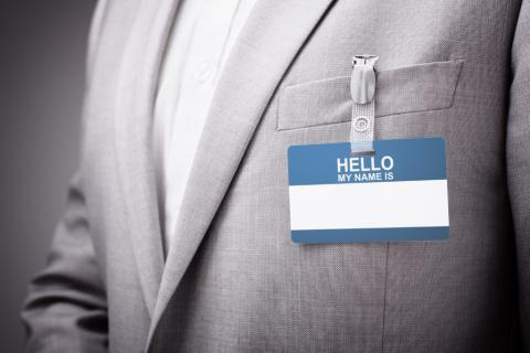 An image of a blank name tag pinned to someone's suit jackethttps://www.pinknews.co.uk/2020/02/29/legal-name-change-clinic-lgbt-university-minnesota-law-school-trans-non-binary/