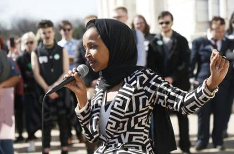 "U.S. Rep Ilhan Omar, D-Minn., speaks to support LGBTQ and allied high school students from across the state of Minnesota who marched to the State Capitol steps Thursday, March 21, 2019 in St. Paul, Minn. to urge lawmakers to protect LGBTQ Minnesotans and youth from the effects of so-called conversion ""therapy."""