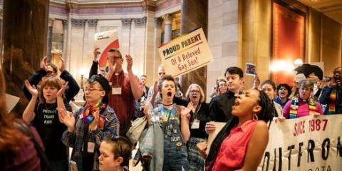 More than 100 protesters sang and cheered in the State Capitol last month as House representatives discussed an amendment regarding conversion therapy. Minnesota has not banned the practice. Photo by Glen Stubbe of the Star Tribune.