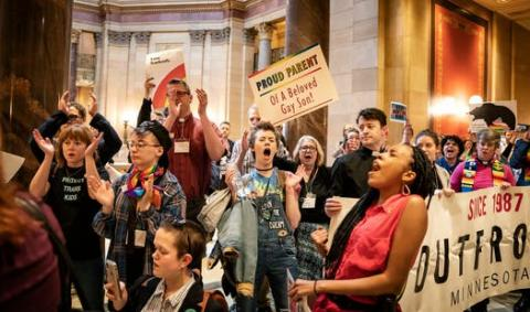 Protesters with OutFront Minnesota sang and cheered outside the Capitol's House chambers in April 2019 as members debated an amendment about banning conversion therapy.https://www.startribune.com/st-paul-city-council-considers-banning-conversion-therapy-for-minors/569179822/